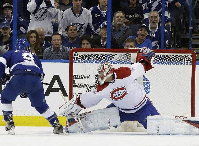 Tampa Bay Lightning center Tyler Johnson (9) scores past Montreal Canadiens goalie Carey Price (31) during the third period of an NHL hockey game Tuesday, April 1, 2014, in Tampa, Fla. The Lightning won 3-1