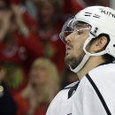 FILE - In this May 18, 2014, file photo, Los Angeles Kings' Slava Voynov (26) reacts after Chicago Blackhawks' Duncan Keith scored during the second period in Game 1 of the Western Conference finals in the NHL hockey Stanley Cup playoffs in Chicago. The NHL has indefinitely suspended Voynov because of domestic violence charges. The league says he was arrested Monday morning, Oct. 20, 2014, but isn't providing other details. Police in the Los Angeles suburb of Redondo Beach released limited information early Monday, giving no details of what is alleged to have occurred. (AP Photo/Nam Y. Huh, File)