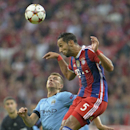 Bayern's Mehdi Benatia, right, heads the ball during the Champions League group E soccer match between Bayern Munich and Manchester City in Munich, Germany, Wednesday Sept.17,2014