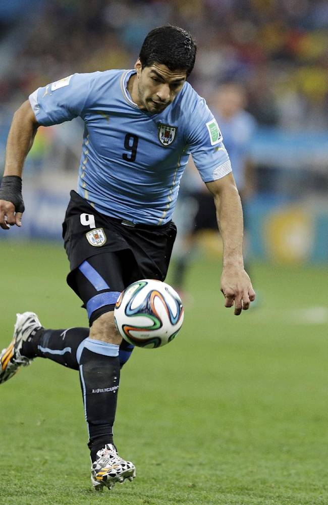 Uruguay's Luis Suarez runs at goal to score the winner during the group D World Cup soccer match between Uruguay and England at the Itaquerao Stadium in Sao Paulo, Brazil, Thursday, June 19, 2014