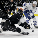 Los Angeles Kings defenseman Brayden McNabb, left, steals the puck from Toronto Maple Leafs left wing James van Riemsdyk during the third period of an NHL hockey game in Los Angeles, Monday, Jan. 12, 2015 The Associated Press