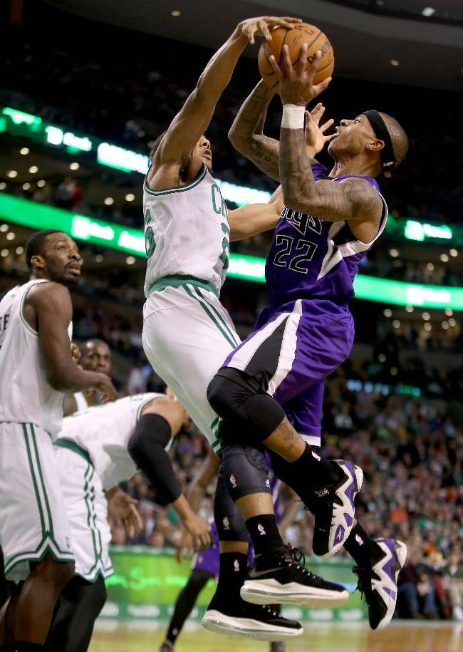 Boston Celtics point guard Phil Pressey (26) blocks a shot-attempt by Sacramento Kings point guard Isaiah Thomas (22) during the second half of an NBA basketball game on Friday, Feb. 7, 2014, in Boston
