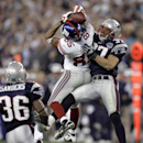 In this Feb. 3, 2008, file photo, New York Giants receiver David Tyree (85) catches a pass while in the clutches of New England Patriots safety Rodney Harrison (37) as James Sanders (36) watches during the fourth quarter of the Super Bowl XLII football ga