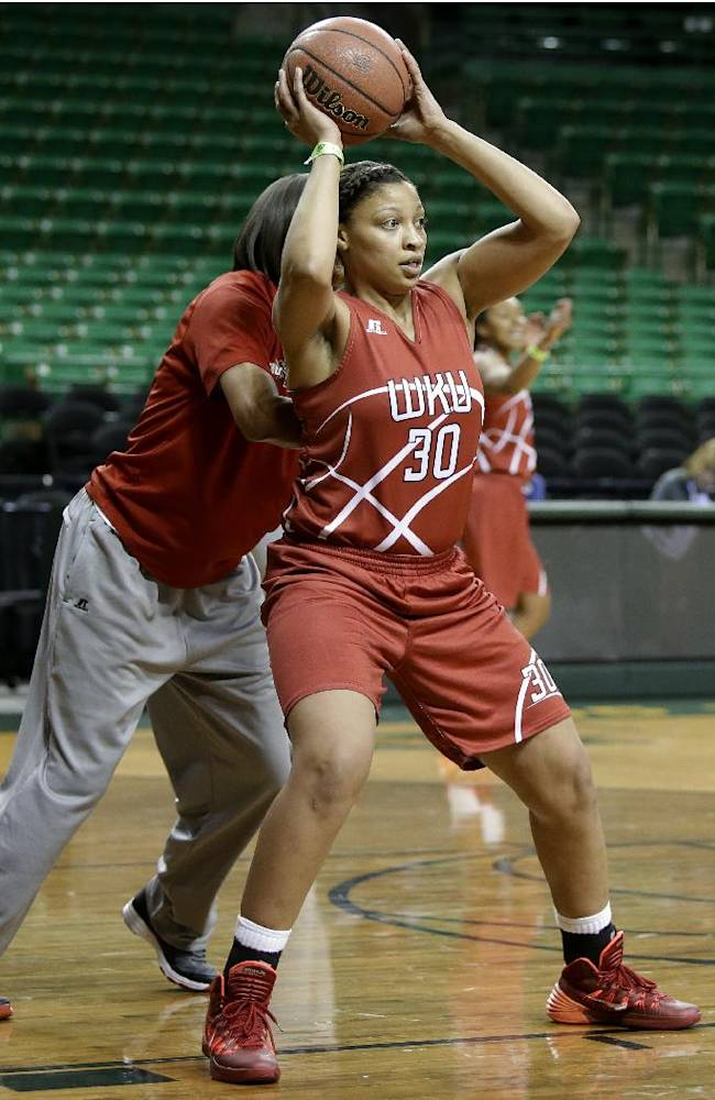 Western Kentucky's Chastity Gooch prepares to pass the ball as the team runs drills during practice for the NCAA women's college basketball tournament, Friday, March 21, 2014, in Waco, Texas. Western Kentucky plays against Baylor in a first-round game on Saturday