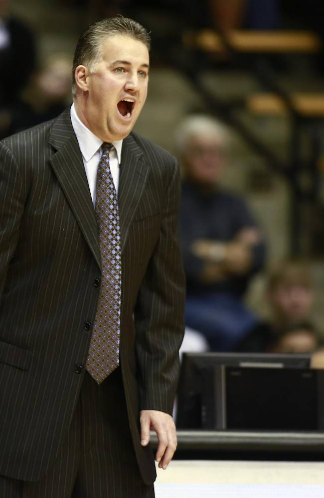Purdue head coach Matt Painter yells to his team in the first half of an NCAA basketball game versus Rider in West Lafayette, Ind., Sunday, Nov. 17, 2013. Purdue won 81-77