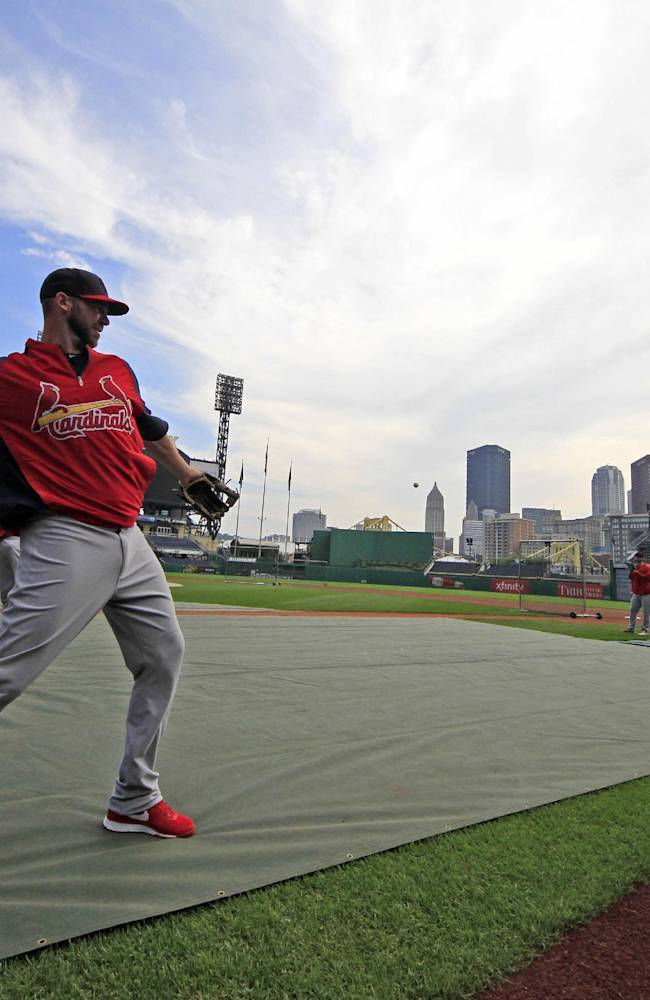 St. Louis Cardinals' Chris Carpenter plays catch during a baseball workout at PNC Park Saturday, Oct. 5, 2013, in Pittsburgh. The Cardinals are scheduled the Pittsburgh Pirates in Game 3 of the National League division series on Sunday