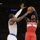 Washington Wizards' John Wall (2) shoots over New York Knicks' Amar'e Stoudemire (1) during the second half of an NBA basketball game Friday, April 4, 2014, in New York. The Wizards won the game 89-90 The Associated Press
