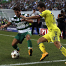 Chelsea's Eden Hazard, right, and Sporting's Cedric Soares challenge for the ball during a Champions League, Group G soccer match between Sporting and Chelsea, in Lisbon, Tuesday, Sept. 30, 2014