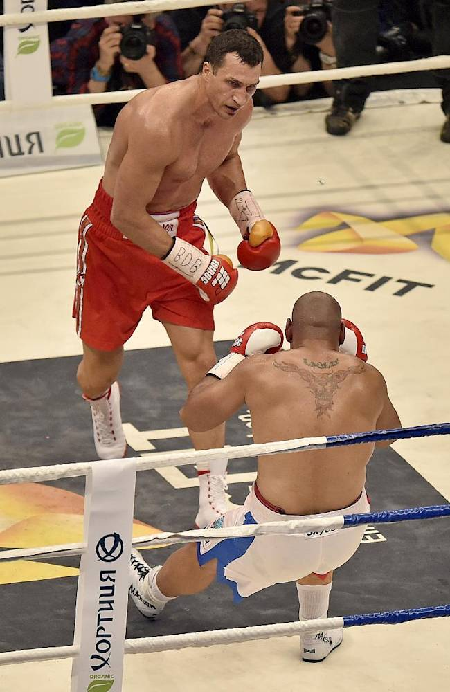 World boxing champion Wladimir Klitschko of Ukraine, left, knocks down Samoan-born Australian challenger Alex Leapai for the third time  during their IBF, IBO, WBO and WBA heavyweight title bout in Oberhausen, Germany, Saturday, April 26, 2014. Klitschko won the fight by technical knock out in the fifth round