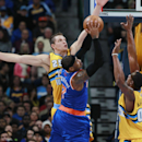 New York Knicks forward Carmelo Anthony, center, has his shot blocked by Denver Nuggets center Timofey Mozgov, left, of Russia, as forward Darrell Arthur helps defend during the third quarter of the Nuggets' 97-95 victory in an NBA basketball game in Denv