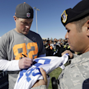Dallas Cowboys' Jason Witten signs autographs after a practice session at Luke Air Force Base for the NFL Football Pro Bowl Thursday, Jan. 22, 2015, in Glendale, Ariz The Associated Press