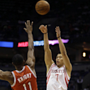Houston Rockets' Jeremy Lin (7) shoots against Milwaukee Bucks' Brandon Knight (11) during the first half of an NBA basketball game Saturday, Feb. 8, 2014, in Milwaukee The Associated Press