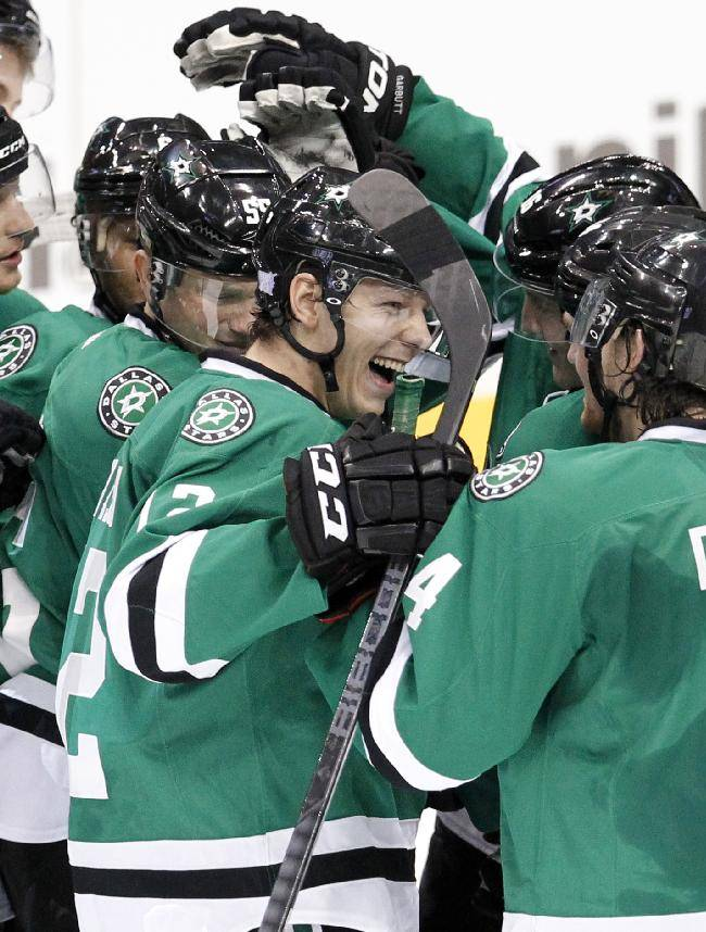 Dallas Stars' Alex Chiasson, center, celebrates with teammates on the ice following after their NHL hockey game against the San Jose Sharks, Thursday, Oct. 17, 2013, in Dallas. Chiasson scored a shootout goal that helped the Stars to the 4-3 win