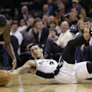 New Orleans Pelicans' Al-Farouq Aminu (0) and San Antonio Spurs' Danny Green, right, scramble for a loose ball during the first half of an NBA basketball game, Monday, Nov. 25, 2013, in San Antonio The Associated Press