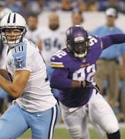 Tennessee Titans quarterback Jake Locker is chased by Minnesota Vikings defensive end George Johnson, right, during the first half of an NFL preseason football game Thursday, Aug. 29, 2013, in Minneapolis. (AP Photo/Ann Heisenfelt)