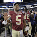 Florida State quarterback Jameis Winston (5) celebrates after winning the Atlantic Coast Conference championship NCAA college football game against Georgia Tech in Charlotte, N.C., Saturday, Dec. 6, 2014. Florida State won 37-35 The Associated Press