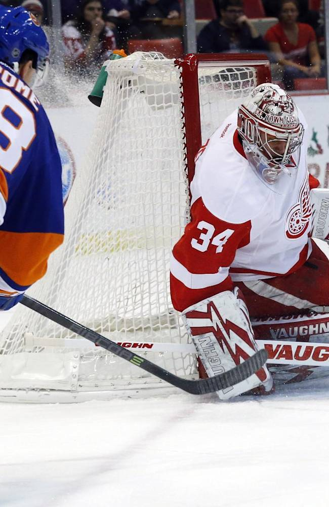 Detroit Red Wings goalie Petr Mrazek (34), of the Czech Republic, stops a New York Islanders center Ryan Strome (18) shot in the first period of an NHL hockey game, Monday, Dec. 23, 2013,in Detroit