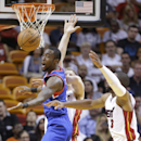 Philadelphia 76ers guard Tony Wroten has the ball stripped away by Miami Heat guard Dwyane Wade, right, while going up to shoot during the first half of an NBA basketball game on Wednesday, April 16, 2014, in Miami The Associated Press