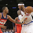 Washington Wizards' Trevor Ariza (1) defends New York Knicks' Carmelo Anthony (7) during the first half of an NBA basketball game Friday, April 4, 2014, in New York The Associated Press