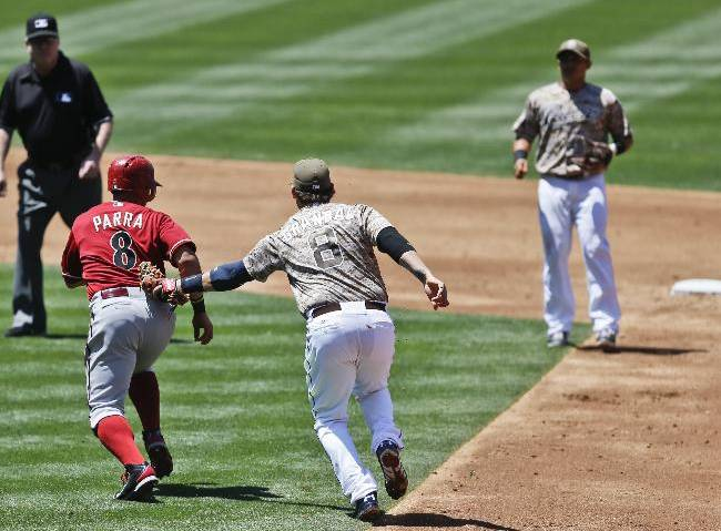 Arizona Diamondbacks' Gerardo Parra is tagged out by San Diego Padres first baseman Yasmani Grandal after being picked off during the third inning of a baseball game Sunday, May 4, 2014, in San Diego