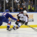 Colorado Avalanche's Matt Duchene, right, controls the puck against New York Islanders' Calvin de Haan (44) in the third period of an NHL hockey game on Saturday, Feb. 8, 2014, in Uniondale, N.Y. Duchene scored two goals during the Avalanche's 4-2 win The