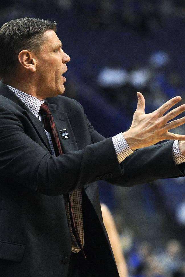 Loyola of Chicago coach Porter Moser gestures to his team during the second half of an NCAA college basketball game against Indiana State in the quarterfinals of the Missouri Valley Conference men's tournament, Friday, March 7, 2014  in St. Louis