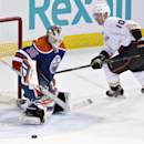 Anaheim Ducks Corey Perry (10) is stopped by Edmonton Oilers goalie Viktor Fasth (35) during third period NHL hockey action in Edmonton, Alberta, on Sunday April 6, 2014 The Associated Press