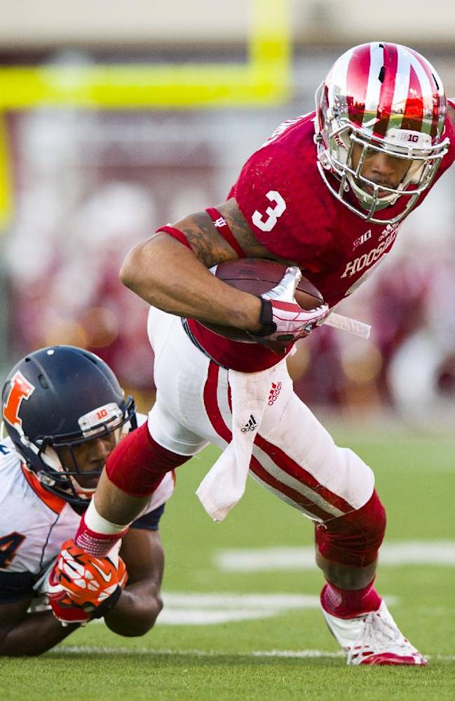 Indiana's Cody Latimer (3) is tackled by Illinois' Darius Mosely (24) during the first half of an NCAA college football game, Saturday, Nov. 9, 2013, in Bloomington, Ind