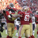 San Francisco 49ers running back Frank Gore is lifted by teammates after running for an 8-yard touchdown during the second quarter of an NFL football game against the Chicago Bears in Santa Clara, Calif., Sunday, Sept. 14, 2014. (AP Photo/Marcio Jose Sanchez)