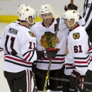 Chicago Blackhawks Jeremy Morin, left, and Garret Ross, right, congratulate teammate Duncan Keith on his goal against the Edmonton Oilers during second period NHL pre-season action in Saskatoon, Saskatchewan, Sunday, Sept 28, 2014. The Associated Press