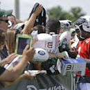 New York Jets quarterback Michael Vick (1) signs autographs for fans after practice during an NFL football training camp on Saturday, July 26, 2014, in Cortland, N.Y The Associated Press