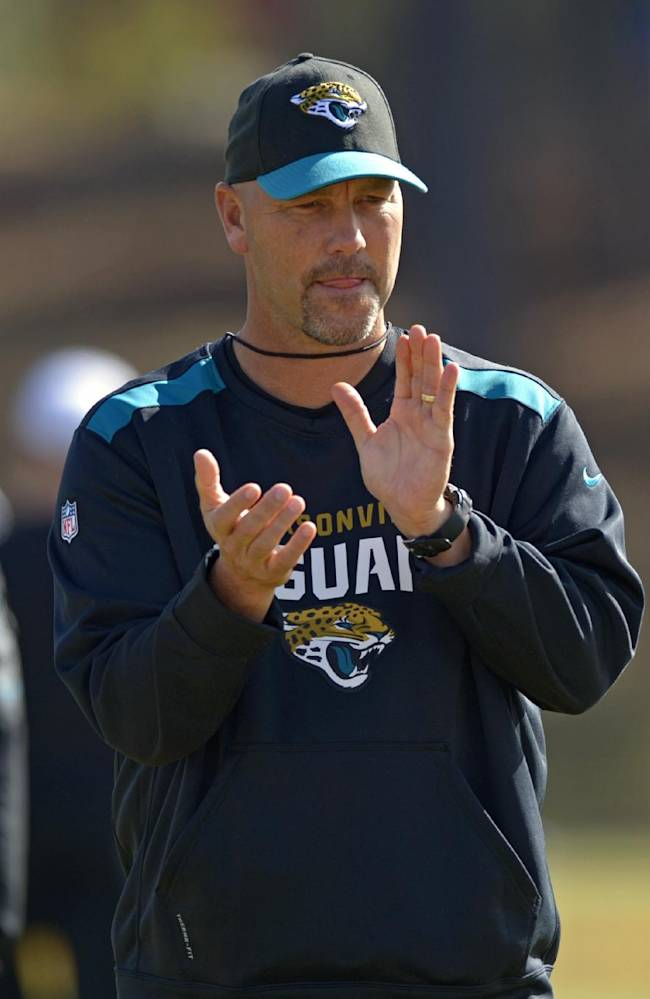 South Squad head coach Gus Bradley of the Jacksonville Jaguars claps as his players stretch during Senior Bowl practice at Fairhope Municipal Stadium, Monday, Jan. 20, 2014 in Fairhope, Ala
