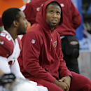 Injured Arizona Cardinals wide receiver Larry Fitzgerald looks at the scoreboard as he sits on the bench in the second half of an NFL football game against the Seattle Seahawks, Sunday, Nov. 23, 2014, in Seattle.The Seahawks won 19-3. (AP Photo/Stephen Brashear)