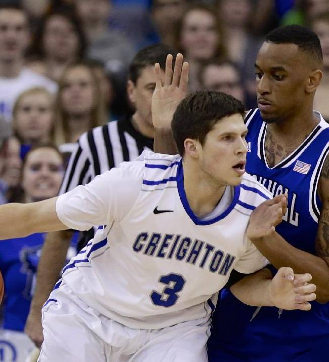 Creighton's Doug McDermott (3) drives around Seton Hall's Brandon Mobley (2) in the first half of an NCAA college basketball game in Omaha, Neb., Sunday, Feb. 23, 2014