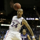 Kansas guard Travis Releford (24) celebrates after dunking the ball during the second half of the championship NCAA college basketball game against Kansas State in the Big 12 men's tournament on Saturday, March 16, 2013, in Kansas City, Mo. (AP Photo/Charlie Riedel)