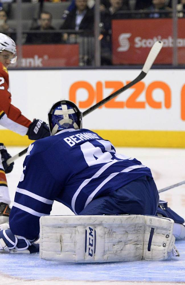 Florida Panthers' Nick Bjugstad (27) scores on Toronto Maple Leafs goalie Jonathan Bernier during the first period of an NHL hockey game in Toronto on Thursday, Jan. 30, 2014