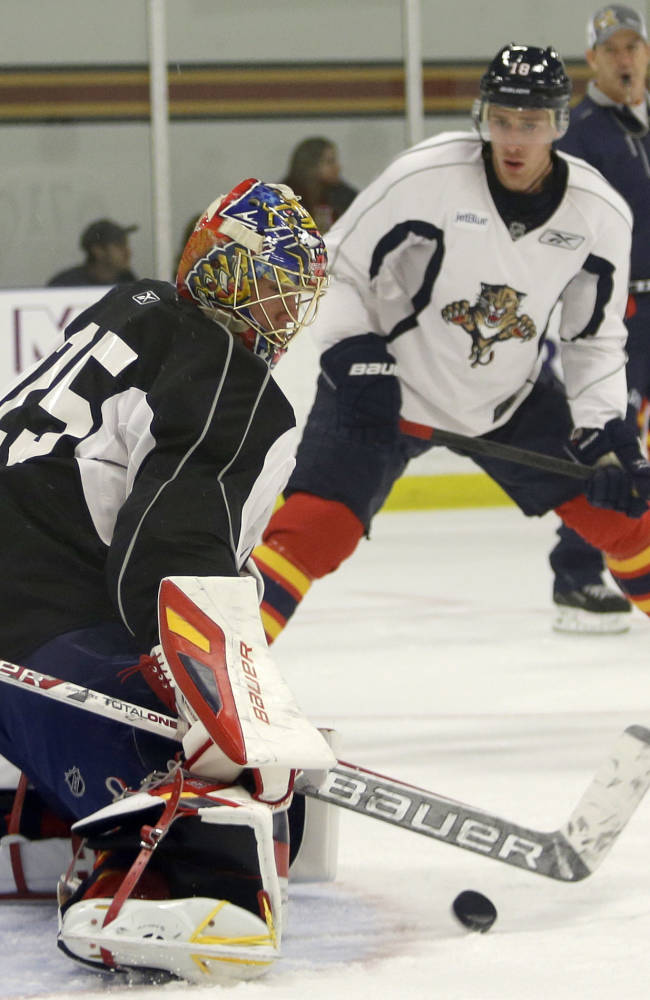 Florida Panthers goalie Jacob Markstrom (25), of Sweden, blocks a shot during NHL hockey training camp Thursday, Sept. 12, 2013, in Coral Springs, Fla