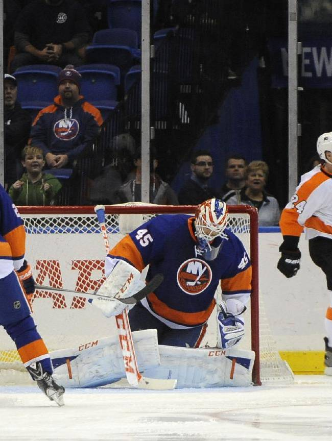 Philadelphia Flyers' Matt Read (24) celebrates his goal against New York Islanders goalie Anders Nilsson (45) in the second period of an NHL hockey game on Monday, Jan. 20, 2014, in Uniondale, N.Y