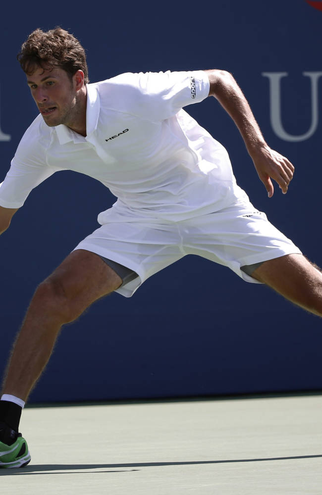 Robin Haase, of the Netherlands, returns a shot against Andy Murray, of the United Kingdom, during the opening round of the 2014 U.S. Open tennis tournament, Monday, Aug. 25, 2014, in New York