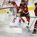 Florida Panthers goalie Al Montoya looks back as Calgary Flames' Matt Stajan second form right scores during the third period of an NHL hockey game Friday, Jan. 9, 2015, in Calgary, Alberta The Associated Press