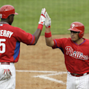 Philadelphia Phillies' Carlos Ruiz, right, celebrates with teammate John Mayberry Jr., left, after hitting a home run in the fifth inning of an exhibition baseball game against the New York Yankees Thursday, March 6, 2014, in Clearwater, Fla The Associate