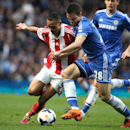 Chelsea's Cesar Azpilicueta, right, challenges Stoke City's Peter Odemwingie during their English Premier League soccer match between Chelsea and Stoke City at Stamford Bridge stadium in London, Saturday, April, 5, 2014