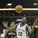 Memphis Grizzlies' Quincy Pondexter (20) loses the ball in front of Brooklyn Nets' Joe Johnson (7) during the second half of an NBA basketball game in Memphis, Tenn., Saturday, Nov. 30, 2013. Pondexter made 22 points and Johnson made 26 as the Nets defeat