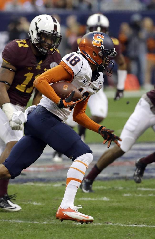 Syracuse wide receiver Christopher Clark (18) runs for a first down after catching a pass as Minnesota's Antonio Johnson (11) and Brock Vereen (21) defend during the first quarter of the Texas Bowl NCAA college football game on Friday, Dec. 27, 2013, in Houston