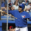 Toronto Blue Jays' Dioner Navarro tosses his bat after striking out swinging with Melky Cabrera on first in the sixth inning of a spring training baseball game against the Minnesota Twins in Dunedin, Fla., Saturday, March 8, 2014 The Associated Press