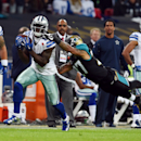 Dallas Cowboys wide receiver Dez Bryant (88) catches a 68-yard touchdown pass asJacksonville Jaguars cornerback Dwayne Gratz (27) defends during the second half of an NFL football game at Wembley Stadium, London, Sunday, Nov. 9, 2014 The Associated Press