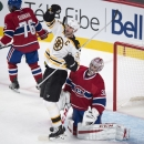 Boston Bruins' Zdeno Chara (33) celebrates his power-play goal past Montreal Canadiens goalie Carey Price during first-period NHL hockey game action Thursday, Oct. 16, 2014, in Montreal The Associated Press