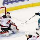 New Jersey Devils goalie Martin Brodeur knocks away the puck, shot by San Jose Sharks' Tomas Hertl, right, during the second period of an NHL hockey game, Saturday, Nov. 23, 2013 i San Jose, Calif The Associated Press