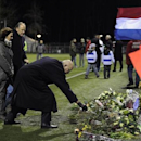 Michael van Praag, president of the Royal Dutch Football Association (KNVB), places flowers on the pitch of the soccer club Buitenboys after attending a silent march to commemorate linesman Richard Nieuwenhuizen in Almere December 9, 2012. REUTERS/Toussaint Kluiters/United Photos