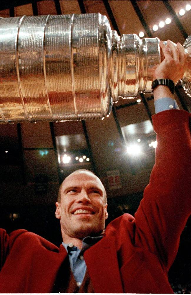 In this June 15, 1994 file photo, New York Rangers captain Mark Messier holds the Stanley Cup trophy overhead during half time of game four of the NBA finals at New York's Madison Square Garden in New York.  It has taken nearly 20 years for Mark Messier's nephew to get back in action at Madison Square Garden. Back then, as an infant, he sat in the Stanley Cup as the New York Rangers celebrated their first NHL championship in 54 years
